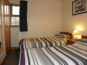 Twin bedroom in two bedroom lodge